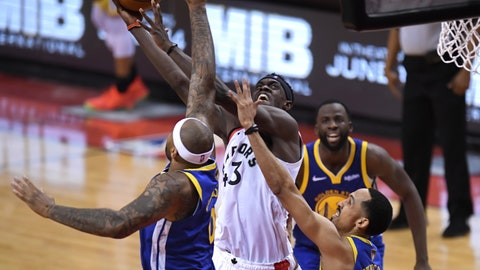 <p>               Toronto Raptors forward Pascal Siakam (43) scores as Golden State Warriors center DeMarcus Cousins (0) and guard Shaun Livingston, right, defend during the second half of Game 1 of basketball's NBA Finals, Thursday, May 30, 2019, in Toronto. (Frank Gunn/The Canadian Press via AP)             </p>