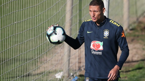 <p>               Richarlison holds a ball during a training session of Brazil national soccer team in Porto Alegre, Brazil, Wednesday, June 26, 2019. Brazil will play against Paraguay for a Copa America quarter-final match on June 27.(AP Photo/Natacha Pisarenko)             </p>
