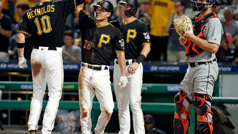 <p>               Pittsburgh Pirates' Bryan Reynolds (10) celebrates with Adam Frazier (26) and Kevin Newman after hitting a three-run home run off Detroit Tigers relief pitcher Nick Ramirez during the sixth inning of a baseball game in Pittsburgh, Wednesday, June 19, 2019. (AP Photo/Gene J. Puskar)             </p>