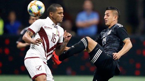 <p>               Mexico's Roberto Alvarado (24) and Venezuela's Roberto Rosales (16) vie for the ball in the first half of an international friendly soccer match Wednesday, June 5, 2019, in Atlanta. (AP Photo/John Bazemore)             </p>
