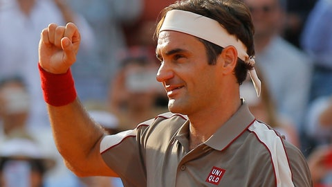 <p>               Switzerland's Roger Federer celebrates winning his quarterfinal match of the French Open tennis tournament against Switzerland's Stan Wawrinka in four sets, 7-6 (7-4), 4-6, 7-6 (7-5), 6-4, at the Roland Garros stadium in Paris, Tuesday, June 4, 2019. (AP Photo/Michel Euler)             </p>