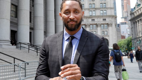 <p>               Former assistant basketball coach for the University of Southern California Tony Bland leaves federal court in New York, Wednesday, June 5, 2019. Bland was the first of four ex-coaches charged with crimes to plead guilty to bribery conspiracy. He was sentenced to 100 hours of community service and two years of probation. (AP Photo/Richard Drew)             </p>