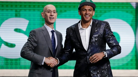 <p>               NBA Commissioner Adam Silver poses for photographs with Washington's Matisse Thybulle after the Boston Celtics selected him as the 20th pick overall in the NBA basketball draft Thursday, June 20, 2019, in New York. (AP Photo/Julio Cortez)             </p>