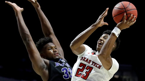 <p>               FILE - In this March 24, 2019, file photo, Texas Tech's Jarrett Culver (23) shoots past Buffalo's Nick Perkins (33) during the second half of a second round men's college basketball game in the NCAA Tournament, in Tulsa, Okla. With the No. 5 and 26 picks in the NBA Draft, the Cleveland Cavaliers could be in position to select Texas Tech's Jarrett Culver, Virginia forward De'Andre Hunter or Duke's Cam Reddish. (AP Photo/Charlie Riedel, File)             </p>