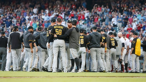 <p>               Pittsburgh Pirates starting pitcher Joe Musgrove (59) is held back by his teammates during a brief scuffle with the Atlanta Braves in the first inning of a baseball game Monday, June 10, 2019, in Atlanta. Musgrove was ejected from the game. (AP Photo/John Bazemore)             </p>
