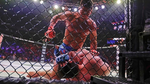 <p>               Brazil's Lyoto Machida, above, punches Chael Sonnen during the second round of a light heavyweight mixed martial arts bout at Bellator 222 early Saturday, June 15, 2019, in New York. Machida stopped Sonnen in the second round. (AP Photo/Frank Franklin II)             </p>