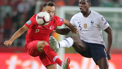 <p>               Turkey's forward Kenan Karaman, left, is challenged by France's midfielder Paul Pogba during the Euro 2020 Group H qualifying soccer match between Turkey and France in Konya, Turkey, Saturday June 8, 2019. (AP Photo)             </p>