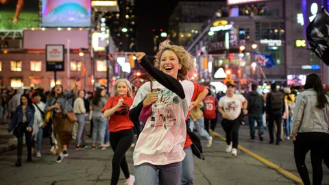 <p>               Toronto Raptors supporters celebrate in the streets after the Raptors defeated the Golden State Warriors during Game 6 NBA Finals to win the NBA Championship, in Toronto on Thursday, June 13, 2019. (Christopher Katsarov/The Canadian Press via AP)             </p>