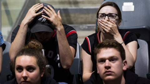 <p>               Toronto Raptors fans react during the last seconds of Game 5 of the NBA Final between the Toronto Raptors and Golden State Warriors on a big screen inside the Leon's Centre in Kingston, Ontario, on Monday June 10, 2019. (Lars Hagberg/The Canadian Press via AP)             </p>