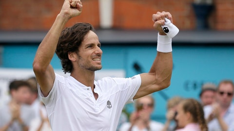 <p>               Feliciano Lopez of Spain celebrates after defeating Gilles Simon of France 6-2/6-7/7-6 in their men's singles final match at the Queens Club tennis tournament in London, Sunday, June 23, 2019. (AP Photo/Tim Ireland)             </p>