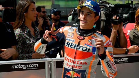 <p>               Spain's Marc Marquez celebrates after setting the fastest time in the qualifying session for the MotoGP Grand Prix of Italy at the Mugello circuit, in Scarperia, Italy, Saturday, June 1, 2019. (Claudio Giovannini/ANSA via AP)             </p>