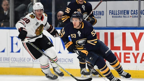 <p>               FILE - In this Feb. 10, 2019, file photo, Buffalo Sabres center Jeff Skinner (53) skates with the puck away from Chicago Blackhawks left wing Brandon Saad (20) during the first period of an NHL hockey game in Buffalo, N.Y. The Sabres have re-signed leading scorer Skinner to an eight year, $72 million contract. (AP Photo/Adrian Kraus, File)             </p>