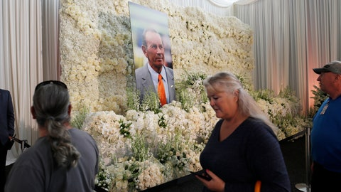 <p>               Fans file past a wall of flowers with a portrait of Denver Broncos owner Pat Bowlen placed in the center during a memorial Tuesday, June 18, 2019, at Mile High Stadium, the NFL football team's home in Denver. Bowlen, who has owned the franchise for more than three decades, died last Thursday. (AP Photo/David Zalubowski)             </p>