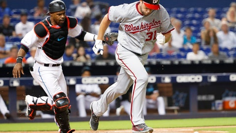 <p>               Washington Nationals' Max Scherzer (31) heads to first with a bunt single as Miami Marlins catcher Wilkin Castillo runs after the ball during the fourth inning of a baseball game Tuesday, June 25, 2019, in Miami. (AP Photo/Wilfredo Lee)             </p>