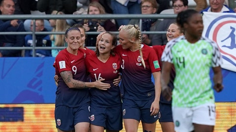 Norway's midfielder Guro Reiten (C) is congratulated by teammates after scoring a goal during the 2019 Women's World Cup Group A football match between Norway and Nigeria, on June 8, 2019, at the Auguste-Delaune Stadium in Reims, eastern France. (Photo by Lionel BONAVENTURE / AFP)        (Photo credit should read LIONEL BONAVENTURE/AFP/Getty Images)