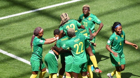 Cameroon's forward Gabrielle Onguene (hidden) is congratulated by teamates after scoring a goal during the France 2019 Women's World Cup Group E football match between the Netherlands and Cameroon, on June 15, 2019, at the Hainaut Stadium in Valenciennes, northern France. (Photo by Philippe HUGUEN / AFP)        (Photo credit should read PHILIPPE HUGUEN/AFP/Getty Images)