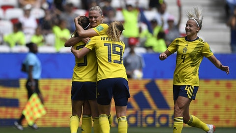 Sweden's midfielder Kosovare Asllani (L) is congratulated by teammates after scoring a goal during the France 2019 Women's World Cup Group F football match between Sweden and Thailand, on June 16, 2019, at the Nice Stadium in Nice, southeastern France. (Photo by CHRISTOPHE SIMON / AFP)        (Photo credit should read CHRISTOPHE SIMON/AFP/Getty Images)
