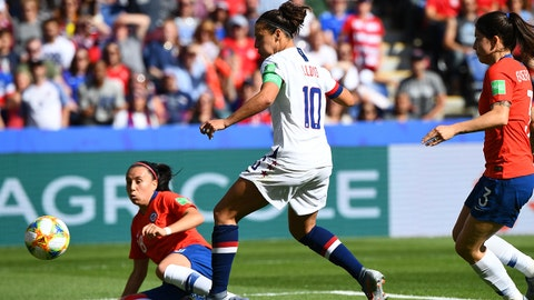 United States' forward Carli Lloyd (C) kicks the ball in front of Chile's midfielder Karen Araya (L)  during the France 2019 Women's World Cup Group F football match between USA and Chile, on June 16, 2019, at the Parc des Princes stadium in Paris. (Photo by FRANCK FIFE / AFP)        (Photo credit should read FRANCK FIFE/AFP/Getty Images)