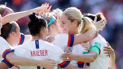 PARIS, FRANCE - JUNE 16: Julie Ertz of USA Women Celebrates 2-0 with Ali Krieger of USA Women, Lindsey Horan of USA Women  during the  World Cup Women  match between USA  v Chile  at the Parc des Princes on June 16, 2019 in Paris France (Photo by Eric Verhoeven/Soccrates/Getty Images)