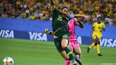 Australia's forward Samantha Kerr (L) vies for the ball with Jamaica's goalkeeper Nicole McClure during the France 2019 Women's World Cup Group C football match between Jamaica and Australia, on June 18, 2019, at the Alpes Stadium Grenoble, central-eastern France. (Photo by Jean-Pierre Clatot / AFP)        (Photo credit should read JEAN-PIERRE CLATOT/AFP/Getty Images)