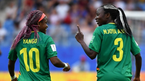 Cameroon's forward Ajara Nchout (R) celebrates with Cameroon's midfielder Jeannette Yango after scoring a goal during the France 2019 Women's World Cup Group E football match between Cameroon and New Zealand, on June 20, 2019, at the Mosson Stadium in Montpellier, southern France. (Photo by Pascal GUYOT / AFP)        (Photo credit should read PASCAL GUYOT/AFP/Getty Images)