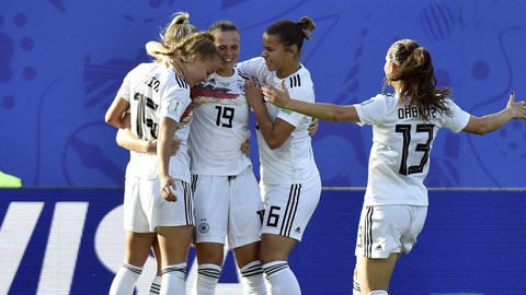 Germany's midfielder Lea Schuller (hidden) is congratulated by teammates after scoring a goal during the France 2019 Women's World Cup round of sixteen football match between Germany and Nigeria, on June 22, 2019, at the Stades des Alpes stadium in Grenoble, central eastern France. (Photo by Jean-Philippe KSIAZEK / AFP)        (Photo credit should read JEAN-PHILIPPE KSIAZEK/AFP/Getty Images)