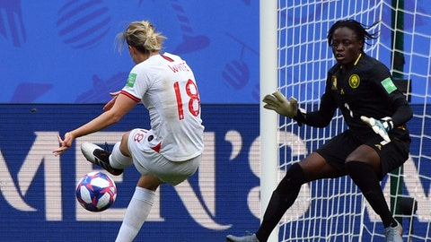 England's forward Ellen White (L) scores a goal despite Cameroon's goalkeeper Annette Ngo Ndom during the France 2019 Women's World Cup round of sixteen football match between England and Cameroon, on June 23, 2019, at the Hainaut stadium in Valenciennes, northern France. (Photo by Philippe HUGUEN / AFP)        (Photo credit should read PHILIPPE HUGUEN/AFP/Getty Images)