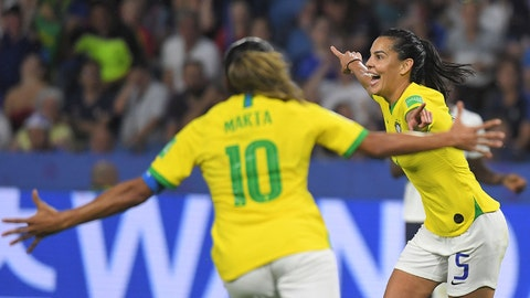 Brazil's midfielder Thaisa (R) celebrates after scoring a goal during the France 2019 Women's World Cup round of sixteen football match between France and Brazil, on June 23, 2019, at the Oceane stadium in Le Havre, north western France. (Photo by LOIC VENANCE / AFP)        (Photo credit should read LOIC VENANCE/AFP/Getty Images)