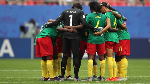 VALENCIENNES, FRANCE - JUNE 23: Cameroon players huddle during the 2019 FIFA Women's World Cup France Round Of 16 match between England and Cameroon at Stade du Hainaut on June 23, 2019 in Valenciennes, France.  (Photo by Molly Darlington - AMA/Getty Images)