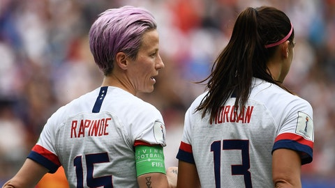 United States' forward Megan Rapinoe (L) speaks with United States' forward Alex Morgan after scoring a penalty during the France 2019 Women's World Cup round of sixteen football match between Spain and USA, on June 24, 2019, at the Auguste-Delaune stadium in Reims, northern France. (Photo by FRANCK FIFE / AFP)        (Photo credit should read FRANCK FIFE/AFP/Getty Images)