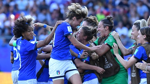 Italy's midfielder Aurora Galli (hidden) is congratulated by teammates after scoring a goal during the France 2019 Women's World Cup round of sixteen football match between Italy and China, on June 25, 2019, at La Mosson stadium in Montpellier, south western France. (Photo by Pascal GUYOT / AFP)        (Photo credit should read PASCAL GUYOT/AFP/Getty Images)