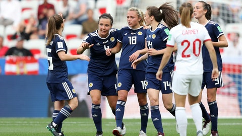 NICE, FRANCE - JUNE 09: Claire Emslie of Scotland celebrates with teammates after scoring her team's first goal during the 2019 FIFA Women's World Cup France group D match between England and Scotland at Stade de Nice on June 09, 2019 in Nice, France. (Photo by Hannah Peters - FIFA/FIFA via Getty Images)