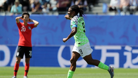 GRENOBLE, FRANCE - JUNE 12: Desire Oparanozie of Nigeria celebrates after Doyeon Kim of Korea Republic scores an own goal, Nigeria's first goal during the 2019 FIFA Women's World Cup France group A match between Nigeria and Korea Republic at Stade des Alpes on June 12, 2019 in Grenoble, France. (Photo by Elsa/Getty Images)