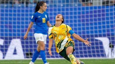 """MONTPELLIER, FRANCE June 13.  Sam Kerr #20 of Australia leads the teams celebrations at the final win after their dramatic come from behind 3-2 win as Luana #18 of Brazil walks off dejected during the Australia V Brazil, Group C match at the FIFA Women""""u2019s World Cup at Stade La Mosson Stadium on June 13th 2019 in Montpellier, France. (Photo by Tim Clayton/Corbis via Getty Images)"""