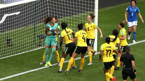REIMS, FRANCE - JUNE 14: Sydney Scheider of Jamaica is congratulated by her teammates for saving a penalty which is then retaken during the 2019 FIFA Women's World Cup France group C match between Jamaica and Italy at Stade Auguste Delaune on June 14, 2019 in Reims, France. (Photo by Robert Cianflone/Getty Images)
