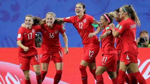 GRENOBLE, FRANCE - JUNE 15: Jessie Fleming of Canada celebrates with teammates after scoring her team's first goal  during the 2019 FIFA Women's World Cup France group E match between Canada and New Zealand at Stade des Alpes on June 15, 2019 in Grenoble, France. (Photo by Elsa/Getty Images)