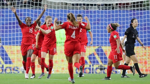 GRENOBLE, FRANCE - JUNE 15: Nichelle Prince of Canada celebrates with teammates after scoring her team's second goal during the 2019 FIFA Women's World Cup France group E match between Canada and New Zealand at Stade des Alpes on June 15, 2019 in Grenoble, France. (Photo by Elsa/Getty Images)