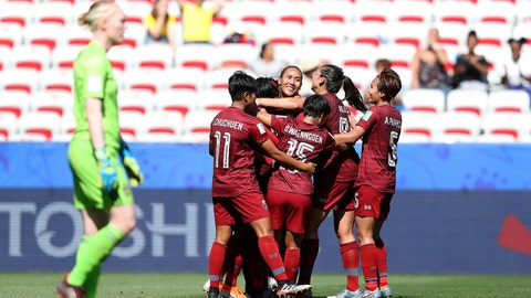 NICE, FRANCE - JUNE 16: Kanjana Sung-Ngoen of Thailand celebrates with teammates after scoring her team's first goal during the 2019 FIFA Women's World Cup France group F match between Sweden and Thailand at Stade de Nice on June 16, 2019 in Nice, France. (Photo by Hannah Peters - FIFA/FIFA via Getty Images)