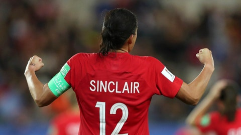 GRENOBLE, FRANCE - JUNE 15:   Christine Sinclair of Canada celebrates towards the fans after her teams victory during the 2019 FIFA Women's World Cup France group E match between Canada and New Zealand at Stade des Alpes on June 15, 2019 in Grenoble, France. (Photo by Naomi Baker - FIFA/FIFA via Getty Images)