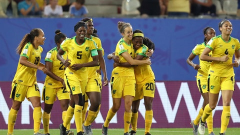 GRENOBLE, FRANCE - JUNE 18: Havana Solaun of Jamaica celebrates with teammates after scoring her team's first goal during the 2019 FIFA Women's World Cup France group C match between Jamaica and Australia at Stade des Alpes on June 18, 2019 in Grenoble, France. (Photo by Naomi Baker - FIFA/FIFA via Getty Images)