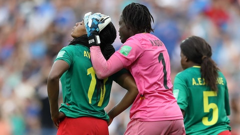 MONTPELLIER, FRANCE - JUNE 20: Aurelle Awona of Cameroon is consoled by Annette Ngo Ndom after she scores an own goal during the 2019 FIFA Women's World Cup France group E match between Cameroon and New Zealand at Stade de la Mosson on June 20, 2019 in Montpellier, France. (Photo by Elsa/Getty Images)