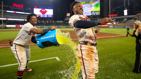 Jun 12, 2019; Atlanta, GA, USA; Atlanta Braves center fielder Ronald Acuna Jr. (13) douses second baseman Ozzie Albies (1) with a bucket after a game against the Pittsburgh Pirates at SunTrust Park. Mandatory Credit: Brett Davis-USA TODAY Sports
