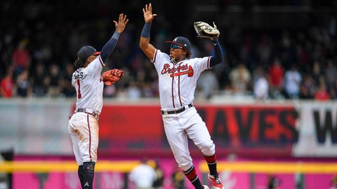 Jun 13, 2019; Atlanta, GA, USA; Atlanta Braves second baseman Ozzie Albies (1) and center fielder Ronald Acuna Jr. (13) react after defeating the Pittsburgh Pirates at SunTrust Park. Mandatory Credit: Dale Zanine-USA TODAY Sports