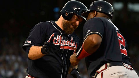 Jun 26, 2019; Chicago, IL, USA; Atlanta Braves catcher Brian McCann (16) high fives Atlanta Braves first base coach Eric Young (2) after he hits a home run against the Chicago Cubs in the second inning at Wrigley Field. Mandatory Credit: Matt Marton-USA TODAY Sports