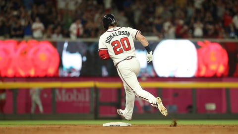 Jun 15, 2019; Atlanta, GA, USA; Atlanta Braves third baseman Josh Donaldson (20) rounds second base after hitting a three-run home run in the fifth inning against the Philadelphia Phillies at SunTrust Park. Mandatory Credit: Jason Getz-USA TODAY Sports