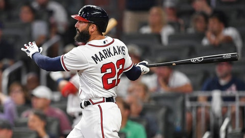 Jun 10, 2019; Atlanta, GA, USA; Atlanta Braves right fielder Nick Markakis (22) hits a home run against the Pittsburgh Pirates during the eighth inning at SunTrust Park. Mandatory Credit: Dale Zanine-USA TODAY Sports