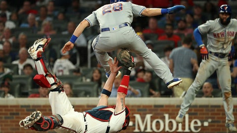 Jun 19, 2019; Atlanta, GA, USA; New York Mets left fielder J.D. Davis (28) is tagged out by Atlanta Braves catcher Tyler Flowers (25) in the sixth inning at SunTrust Park. Mandatory Credit: Jason Getz-USA TODAY Sports