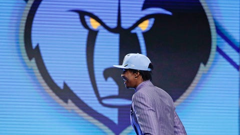 Murray State's Ja Morant walks on stage after being selected with the second pick overall by the Memphis Grizzlies during the NBA basketball draft Thursday, June 20, 2019, in New York. (AP Photo/Julio Cortez)