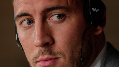 <p>               Belgium forward Eden Hazard attends a press conference after his official presentation after signing for Real Madrid at the Santiago Bernabeu stadium in Madrid, Spain, Thursday, June 13, 2019. Real Madrid announced last week that it had acquired the 28-year-old Belgian playmaker from Chelsea for a reported fee of around 100 million euros ($113 million) plus variables, making him the club's most expensive signing ever. (AP Photo/Manu Fernandez)             </p>