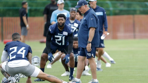<p>               Tennessee Titans defensive coordinator Dean Pees, front right, talks with safety Kenny Vaccaro (24) and cornerback Malcolm Buter (21) during an organized team activity at the Titans' NFL football training facility Tuesday, June 4, 2019, in Nashville, Tenn. Pees wants more than the 39 sacks the Titans managed in 2018, putting them in a tie for 16th in the NFL. Pees has made it clear he's only worried about making sure the Titans do what's asked of them on defense. (AP Photo/Mark Humphrey)             </p>